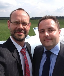 Photo: The CEO and the Sales Director on a grass strip in Poland after a business meeting near by.